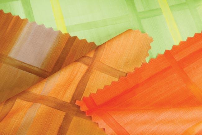 Vodoodpudivý ubrus Káro - oranžová pr. 150 cm.